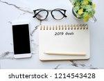 2019 goals on blank note paper... | Shutterstock . vector #1214543428