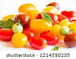 tomatoes of different colors on ... | Shutterstock . vector #1214550235