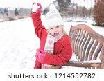 a pretty girl in the snow ... | Shutterstock . vector #1214552782