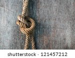 Rope Knot And Weathered Wood...