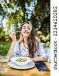 smiling young woman enjoys... | Shutterstock . vector #1214620282