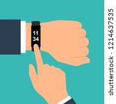 fitness tracker on hand. sport... | Shutterstock .eps vector #1214637535