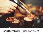 barman prepares glintwein... | Shutterstock . vector #1214644675