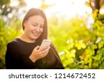 pretty young girl calling to... | Shutterstock . vector #1214672452