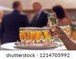 a waitress serves standing... | Shutterstock . vector #1214705992
