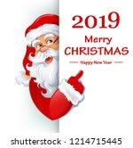 santa claus standing behind a... | Shutterstock .eps vector #1214715445