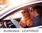enjoying road trip together... | Shutterstock . vector #1214745025