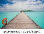 pier at maldives. blue water ... | Shutterstock . vector #1214752048