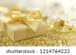 golden gift box covered with... | Shutterstock . vector #1214764222