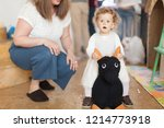 curly little girl sitting on a... | Shutterstock . vector #1214773918