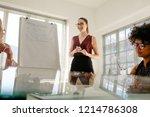 smiling woman standing by flip...   Shutterstock . vector #1214786308