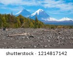 the summits of two volcanoes... | Shutterstock . vector #1214817142