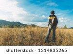 man traveler stand alone on... | Shutterstock . vector #1214835265