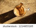 top view steaming cup of coffee ... | Shutterstock . vector #1214855185