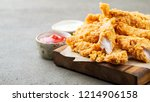 breaded chicken strips with two ... | Shutterstock . vector #1214906158