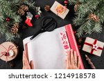 female hands wrapping a... | Shutterstock . vector #1214918578