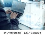 Small photo of BUSINESS PEOPLE Investment Advisory TEAM Analyzes Company's Annual FINANCIAL Statements.Balance Sheets WORK With Graph Papers.Concept Internal AUDIT TAX Return on Investment Analysis Shareholders