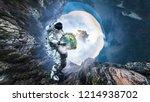 spaceman carry big planet....   Shutterstock . vector #1214938702
