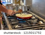 cooking diced onions in a...   Shutterstock . vector #1215011752