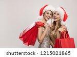 two happy woman in santa hats... | Shutterstock . vector #1215021865