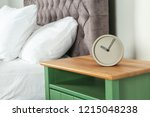 Alarm Clock On Nightstand In...