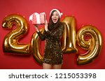 merry santa girl in shiny... | Shutterstock . vector #1215053398