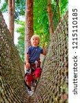 brave little child in safety... | Shutterstock . vector #1215110185
