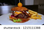 homemade burger with kortoshki... | Shutterstock . vector #1215111388