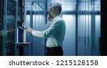 medium shot of technician... | Shutterstock . vector #1215128158