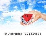 hand holding   offer house.... | Shutterstock . vector #121514536