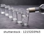 pouring vodka into the glass on ... | Shutterstock . vector #1215203965