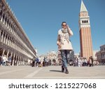 tourist woman walking on the... | Shutterstock . vector #1215227068