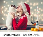 woman with dog at christmas hat.... | Shutterstock . vector #1215250948