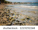 rocky sea shore with wet stones ... | Shutterstock . vector #1215252268