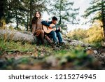 young man playing guitar while... | Shutterstock . vector #1215274945