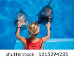 Female Coach With Dolphins....