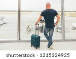 a man in the airport is...   Shutterstock . vector #1215324925