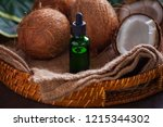 coconut oil with coconuts  ...   Shutterstock . vector #1215344302