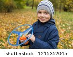 in the autumn park the boy... | Shutterstock . vector #1215352045