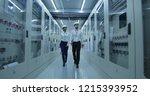 wide shot of electrical workers ... | Shutterstock . vector #1215393952