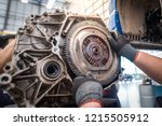 Hands of car mechanic working in auto repair service. - stock photo