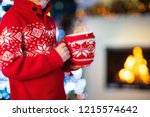child drinking hot chocolate at ... | Shutterstock . vector #1215574642