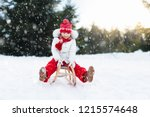 little girl enjoying a sleigh... | Shutterstock . vector #1215574648