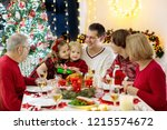 family with children eating... | Shutterstock . vector #1215574672