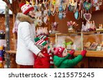 mother and child in warm hat... | Shutterstock . vector #1215575245
