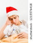 sick young man in santa hat... | Shutterstock . vector #1215576418