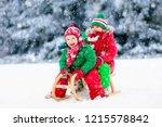 little girl and boy enjoying... | Shutterstock . vector #1215578842