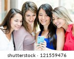 group of girls looking at a... | Shutterstock . vector #121559476