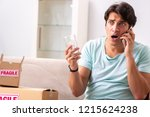man opening fragile parcel... | Shutterstock . vector #1215624238