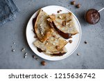 crepes with chocolate spread... | Shutterstock . vector #1215636742